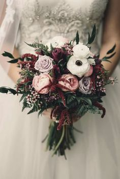 Moody bridal bouquet of fresh roses, peonies, and anemones. Burgundy and blush wedding bouquet.