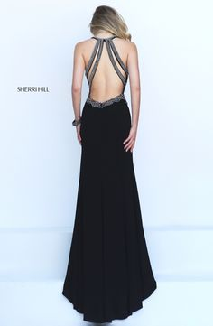 Sultry and sensual, the Sherri Hill 50215 full-length prom dress creates a striking jersey silhouette. https://www.pinterest.com/behzadj/jovani-prom-dresses for other low back prom dresses. The Sherri Hill line is selling out fast.