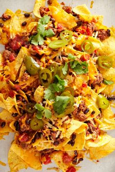 Don't stand for soggy chips. Bake one layer of these loaded nachos before piling on a second helping of tortilla chips, ground beef, black beans, shredded cheese, and chunky salsa. #superbowlrecipes #appetizers #tailgaterecipes #fingerfoods #apps #bhg Game Day Snacks, Game Day Food, Football Party Foods, Chunky Salsa, Tailgate Food, Delicious Sandwiches, Hors D'oeuvres, Tortilla Chips, Nachos