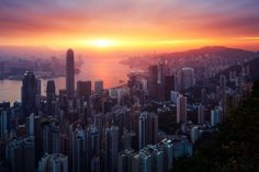 MANDATORY CREDIT: Beboy/REX Shutterstock Editorial use only. Only for use in context of story about Beboy's images of sunrises and sunsets around the world. No stock, advertising, merchandising or books without photographer's permission Mandatory Credit: Photo by Beboy/REX/Shutterstock (5636173k) Sunrise over Hong-Kong's skyline, pictured in June 2014 Man spends years travelling around world to capture sunrises and sunsets - 2016 FULL COPY: http://www.rexfeatures.com/nanolink/s7hp Talented…