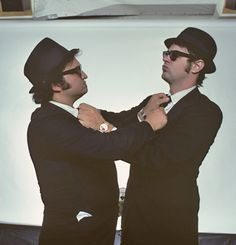 John Belushi and Dan Aykroyd as Joliet Jake and Elwood Blues.  The Blues Brothers was one of my favorite movies growing up, still is actually.