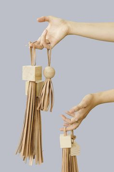 Make these DIY statement tassels with wood blocks and strips of leather for a unique fashion accessory. Use the finished tassels on bags, backpacks, etc.