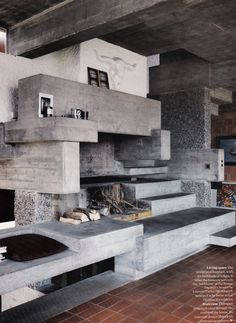 That is a fireplace. Concrete is a great material for this and similarly shaped concepts.