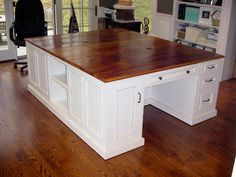 SAVE SOME $$$ with this idea. Double desks and couple stock cabinets in the center, topped with your counter of choice, makes an AFFORDABLE one of a kind kitchen island.