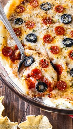 I make this (super easy!) pizza dip every year for the Super Bowl and it is ALWAYS what disappears first. No one realizes it's a lightened-up version!