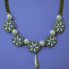 Do you ever have moments where you are looking for the perfect DIY necklace to wear with the cute-as-can-be dress you have picked out, but just cannot find the right one? This DIY Rhinestone and Pearl Statement Necklace is for you.