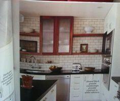 kitchen w white cabinets + walnut cabinets/shelves