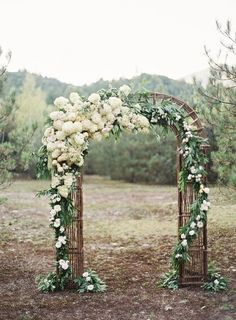 I like how the flowers are concentrated on one side...coincides with bride side.  Might be cool to juxtapose more florals on bride side and twigs, antlers, vines...manly décor... on the groom's side and then tie together with intertwined vine across the two sides