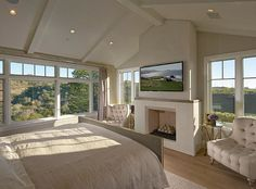 """Bedroom Ideas. Bedroom Design. Bedroom with fireplace, TV and seating area. Chairs are the """"Layla Grayce Garfias Chair"""".  #Bedroom #BedroomIdeas #BedroomDesign"""