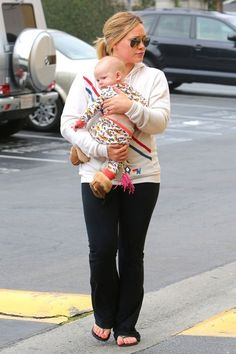 Hilary Duff wearing Ashley Tisdale and Jared at the Dodger Game August 14 2008, So Low Lace Up Foxy Flare Pants, Alexander McQueen Leather and Brass Skull Keyfob, Ray-Ban 3025 Aviator Silver Mirror W3277 and Aviator Nation Pray For Surf Hoodie.