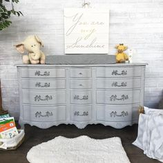 Gorgeous changing dresser for a baby nursery painted with Paris Grey Chalk Paint® | Baby Room Project by Vintage Refined