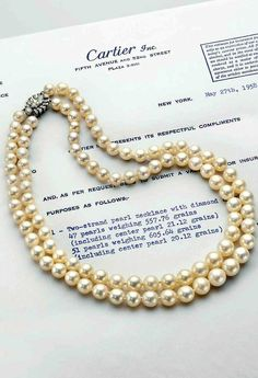 A two-strand natural pearl necklace, by Cartier. https://velvetboxjewelry.com/necklaces?page=2