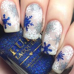 """Snowflake nails!❄️ I used @sally_hansen """"Shell We Dance?"""" as my base, @viragovarnish """"Oxidation"""" & """"Allure"""", and @funlacquer """"How Deep Is Your Holo?"""" from @live.love.polish for the glitter snowflakes, @uberchicbeauty """"Christmas 01 & 02"""" and @bornprettystore """"BPX-L008"""" stamping plates for the white snowflakes, and @whatsupnails """"merry"""" & """"jolly"""" snowflake stencils✨ Tutorial up tomorrow #notd #nailart #viragovarnish #livelovepolish #uberchicbeauty #whatsupnails"""