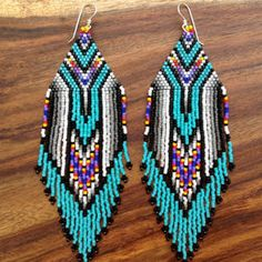 Native Amerian Design Beaded Twisted Turquoise, Red, Orange and Yellow Earrings Delcia