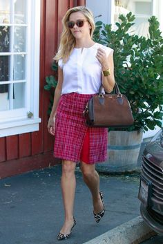 Reese Witherspoon wearing Draper James Lady Satchel in Tobacco, Draper James Susannah Mid Length Tweed Skirt, Draper James Monroe Top