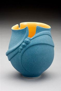 I have a similar vase in my collection and the artistry is incredible, by Michele Rigert