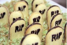 """RIP Cookie Headstones- These are super easy! Take Pepperidge Farms Milano Cookies, cut off ¼ inch off the bottom with a sharp knife. Use black decorating gel to write """"RIP"""". Place on a plate of toasted green coconut for a great """"graveyard"""" setting."""