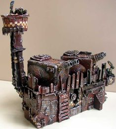 I really like the overall look of GWs Imperial fortifications, but I much prefer the detail on these Orky ones.