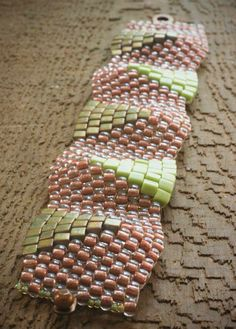 peyote wedge bracelet . pink, bronze & green japanese seed beads woven cuff with snap clasp by val b.