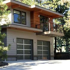 Aluminum And Glass Garage Doors On A Modern Home Frosted Lets Daylight In Without