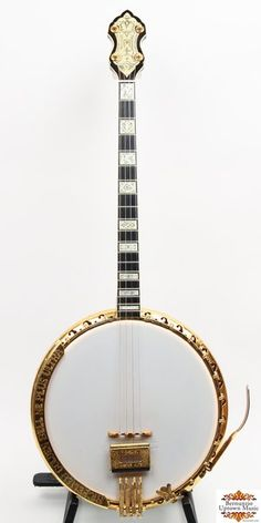 This is a custom instrument that was once part of the collection of C. C. Richelieu. It features Gaboon ebony neck, rim, and resonator, engraved genuine ivory inlays, lion head heel carving, engraved gold metal parts. It is  a faithful recreation of the B