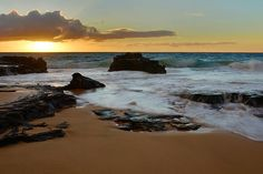 http://fineartamerica.com/featured/sandy-beach-sunrise-7-oahu-hawaii-brian-harig.html