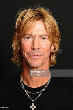 Duff McKagan poses with injured Help For Heroes soldiers ahead of him hosting The Classic Rock Roll of Honour Awards at The Gibson Studio on October 29, 2012 in London, England.