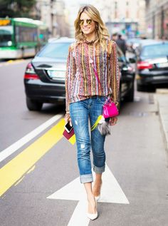 c01f306cb596e A mixed print striped top is paired with cuffed jeans, pumps, mirrored  sunglasses,