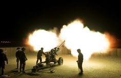 Soldiers with 26 Regiment Royal Artillery fire illumination rounds from the gun line at Camp Bastion, Helmand Province, Afghanistan in support of soldiers operating nearby.