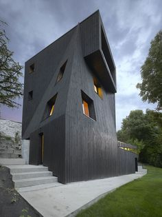 """stealmag: """" studio odile decq positions artists' residency overlooking french valley clad in asphalt, the monolithic black structure emerges from the treetops overlooking the scenic valley in grenoble. The post studio odile decq positions artists'. Architecture Résidentielle, Beautiful Architecture, Contemporary Architecture, Odile Decq, Photo D'architecture, Unique Buildings, City Buildings, Villa, House Design"""