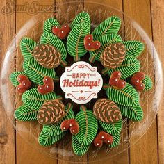 The finished pine wreath cookie platter! The pine branches were made with feather cookie cutters available in my cookie cutter shop. Link in profile! #HappyHolidays #wreath #cookieplatter #decoratedcookies #royalicing #Christmascookies #pinecone by semisweetmike