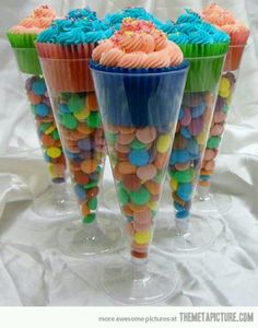 Cupcakes in fluted champagne glasses: Great idea for everything from birthday parties to bridal showers, etc. Use your crystal glasses or pick some up at the Dollar Store. Remember to coordinate the cupcake paper cups  candies to match your party's/gathering's theme.