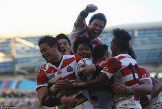 Japan full-back Ayumu Goromaru (left) is mobbed by his team-mates after scoring a try against South Africa in their World Cup opener