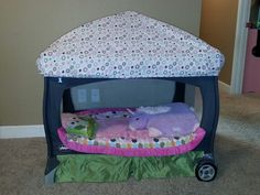 I made Amelia's pack n play into a toddler bed that she LOVES! I cut the mesh out of the front opening, added a toddler sheet to top. And voila, an instant canopy bed for my littlest princess!