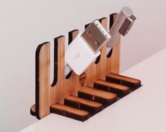 Cable Fondler / Easily and effectively manage your cables. Keep the cables you want on your desk at all times! http://thegadgetflow.com/portfolio/cable-fondler/