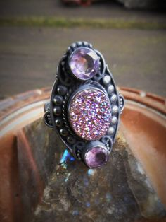 Beautiful purple amethyst and sparkling purple titanium druzy quartz oxidized 925 tri stone silver ring in a size 8 1/2.  Beautiful purple amethyst 3 tier stone ring with a center oval iridescent purple druzy and top and bottom amethyst faceted round stones on a detailed design on either side accented in oxidized darkened silver.  Size 8 1/2 womens  ***Ships out by US Postal Service with insurance in case of loss or damage****