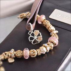 PANDORA Bracelet with Beautiful Gold and Pink.