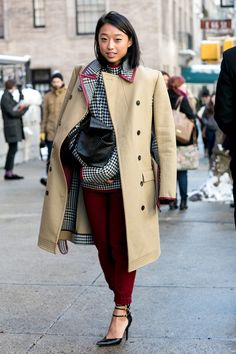 Pick Up Jacket Etiquette The quickest way to tell if a woman works in fashion? How she drapes her jacket while she wears it.
