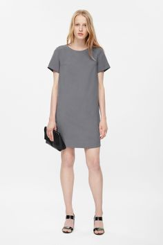 A simple straight-cut shape, this dress has a clean round neckline and neat short sleeves. Made from a lightweight fabric with a soft matte finish, it has a partial back zip fastening and cleanly finished edges.