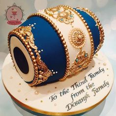 Dholki cake ordered by the lovely Sonia for her son in law, what an awesome gift! ✨ Unfortunately the poor lighting didn't capture the details on the middle panel with topaz blue pearl accents however the blue and ivory combination looked very elegant overall #dholcake #dholkicake #mehndicake #sangeetnight #sugardustbyamina