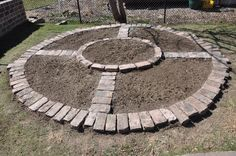 Loving this simple but beautiful compass shape garden bed. Great for defining planting areas for...