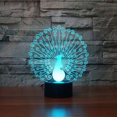 Product Overview The Peafowl (Peacock) 3D LED Illusion Lamp is a combination of art and technology that creates an optical 3D illusion and plays tricks on the eyes. From afar, you will see the design,