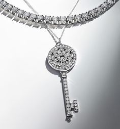 When it comes to modern bridal style, we love the idea of layering. A diamond necklace beautifully complements this #TiffanyKeys petals key pendant with round brilliant diamonds. #TiffanyEngagement #Tiffany #TiffanyAndCo