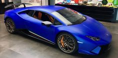 Lamborghini Huracan Performante painted in Blu Aegeus w/ Tricolore stripes along the doors Photo taken by: @Lamborghini_craig on Instagram