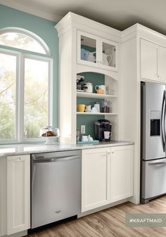 A Coffee Station prevents coffee making (and mess) from intruding on the rest of the kitchen activity.(KraftMaid cabinets in Dove White)