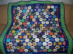 I spy quilt.  Inspired by the game concentration.  2 matching pieces scattered throughout.  Creator of pattern unknown.