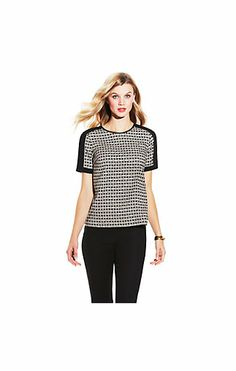 GRAPHIC BASKET BLOUSE-Strong shoulders take charge in the Graphic Basket Blouse by Vince Camuto. Wear it for work with heels and a skirt. We love the basket weave print. a novel alternative to stripes or polka dots.  97. Poly. 3. Spandex