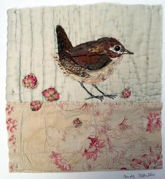 Unframed appliqued wren with embroidery on to vintage quilt