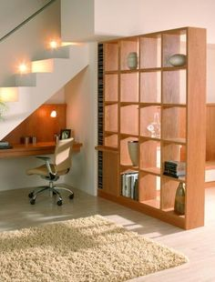 Utilise the space under the stairs  Why not tuck away a work area in this often wasted space? If you have an open-plan living room, use a room divider, screen or tall unit to help section off the work area from other parts of the room.