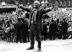 Kop messiah Bill Shankly salutes thousands of fans during a trophy parade in Liverpool City centre http://www.betfred.com/premier-league-centre